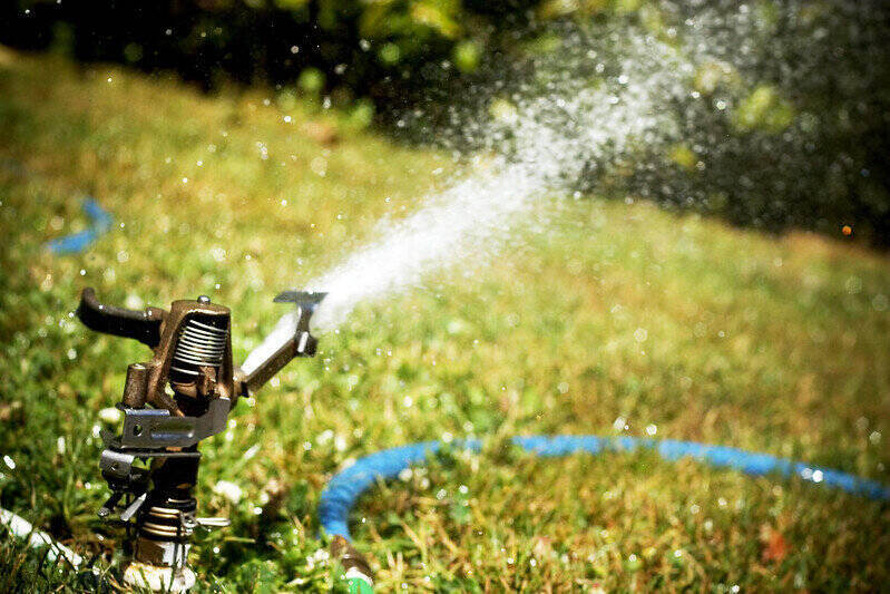 sprinkler on grass shooting out water