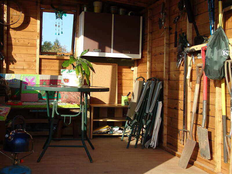 Garden shed with lawn care equipment