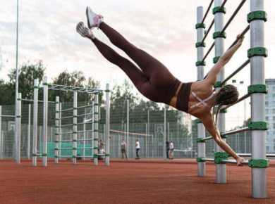 Strong woman is doing exercises and calisthenics